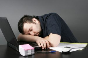man-sleeping-at-desk