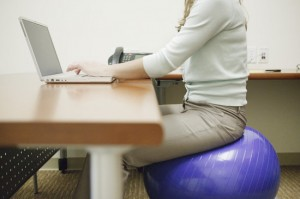 sitting on a yoga ball